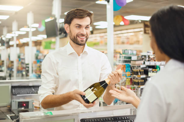 Man buying food products in the supermarket shopping stock photo