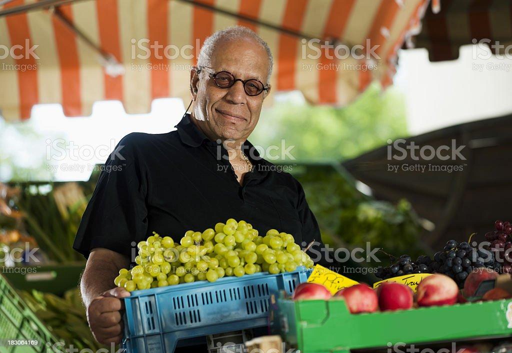 Man Buying Grapes at an Outdoor Market royalty-free stock photo