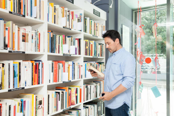 Man buying in a bookstore stock photo
