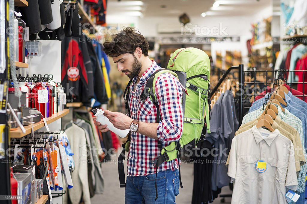 Man buying items in sports store stock photo