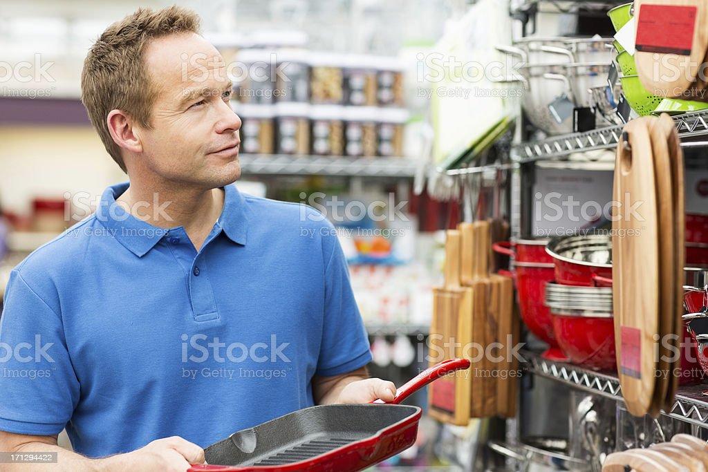 Man Buying Kitchen Utensils royalty-free stock photo
