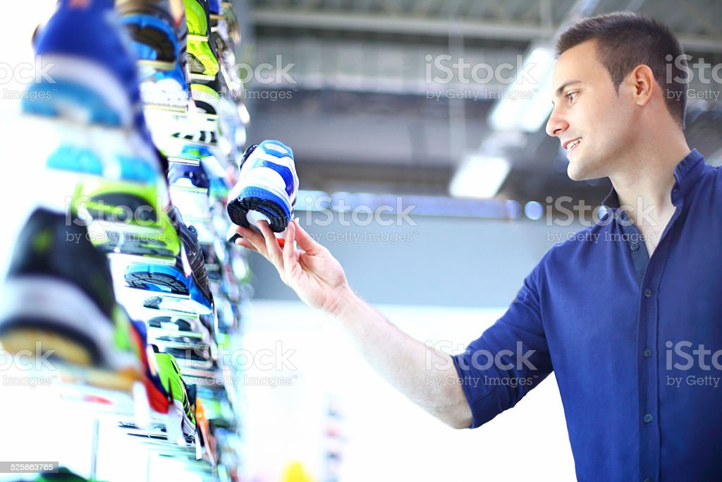 Man buying sport shoes. stock photo