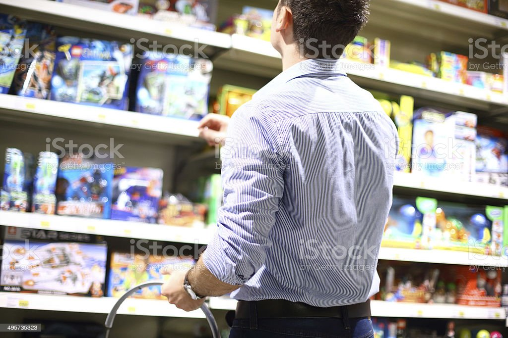 Man buying toys. stock photo