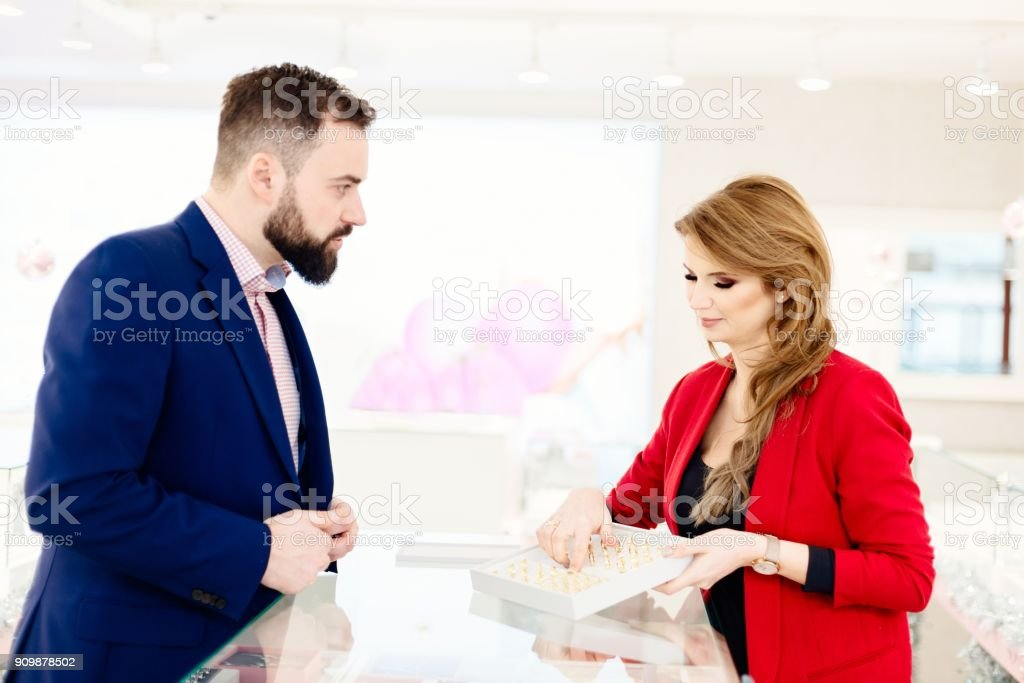 Man Buying Wedding Rings In Jewelry Store Stock Photo
