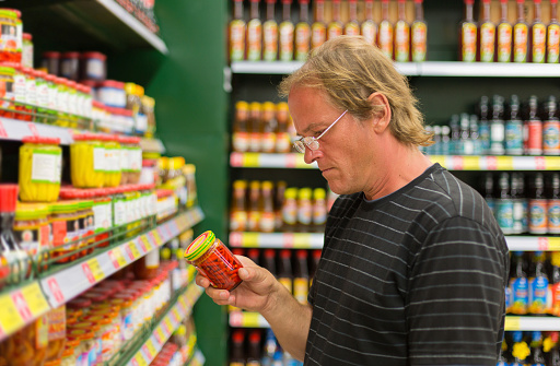 Man Buys Hot Peppers In The Supermarket Stock Photo - Download Image Now