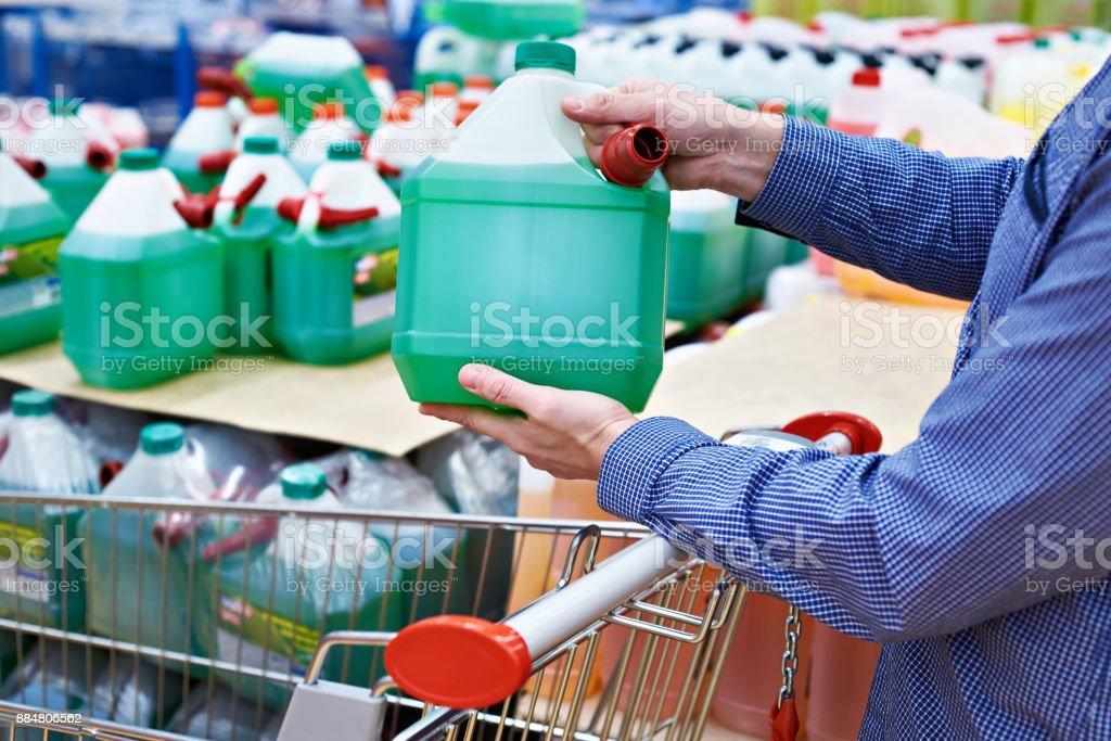 Man buys nonfreezing liquid in shop stock photo