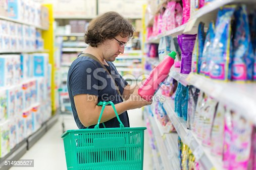 istock Man buys washing powder 514935527