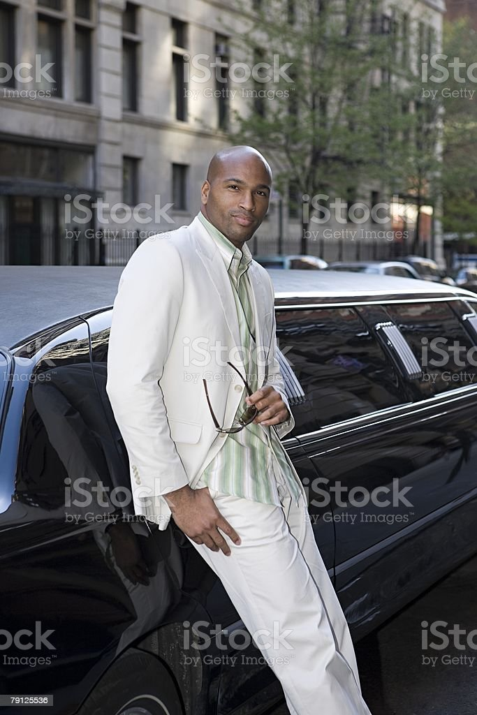 Man by a limousine stock photo