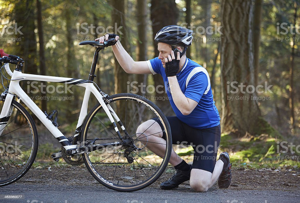 Man by bicycle on phone stock photo