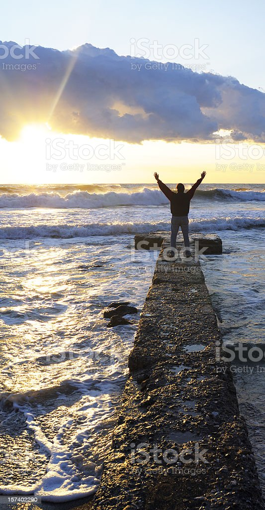 Man by Sea Praying to the Sky royalty-free stock photo