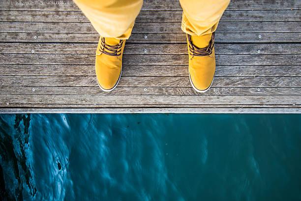 man by the lake - flod vatten brygga bildbanksfoton och bilder