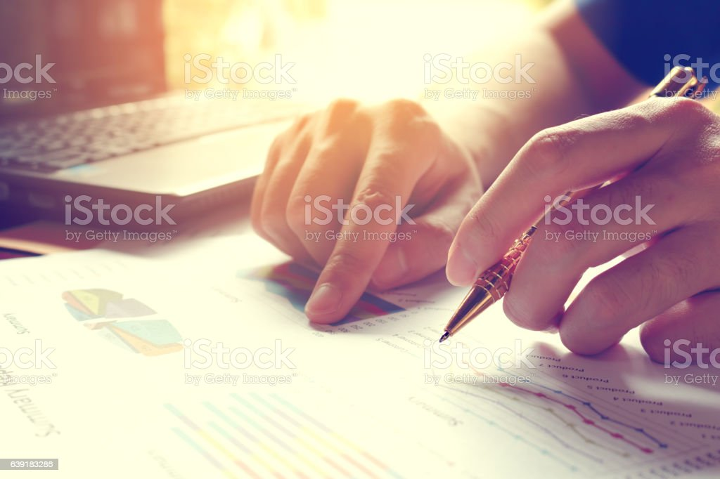 Man calculate cost and expenses and using laptop for search stock photo