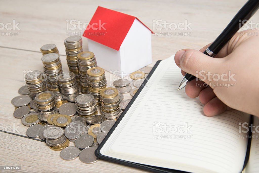 Man calculates the budget before buying the apartment. stock photo