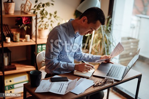 Man calculating his financial bills