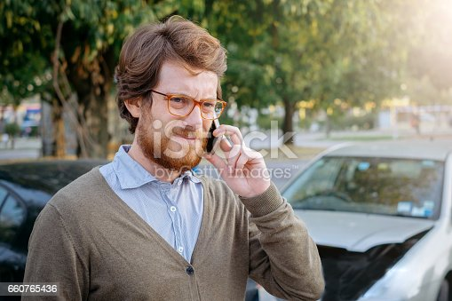1047083324 istock photo Man calling car mechanic insurance assistance after car accident 660765436