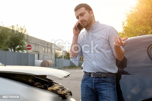 1047083324 istock photo Man calling car mechanic insurance assistance after car accident 660765506