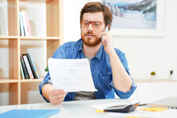 Man calling customer service after unjustified costs complain stock photo