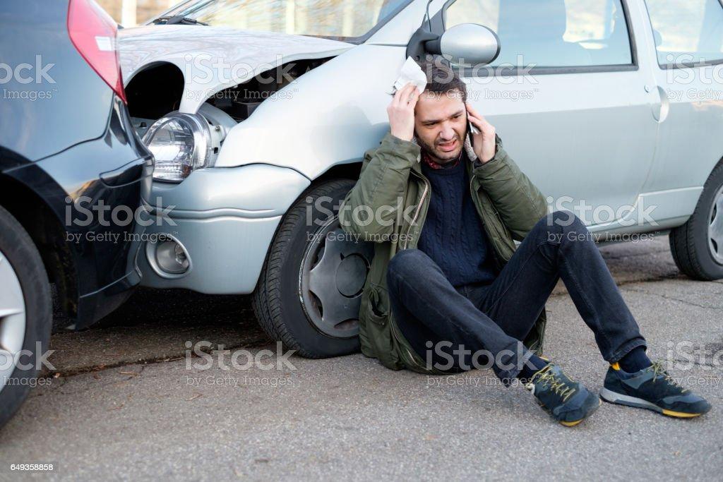 Man calling first aid after car crash stock photo
