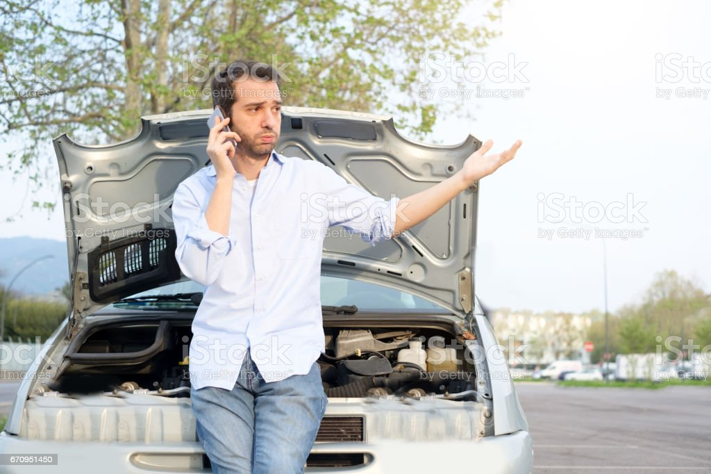 Man calling mechanic after car breakdown stock photo