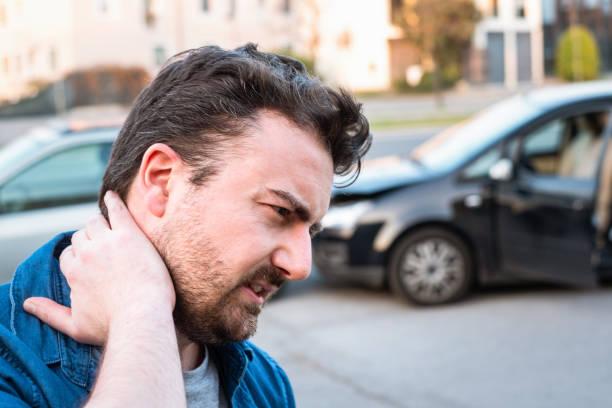 Man calling roadside service after car crash stock photo