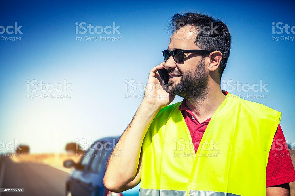 Man calling to insurance company after a car breakdown. stock photo