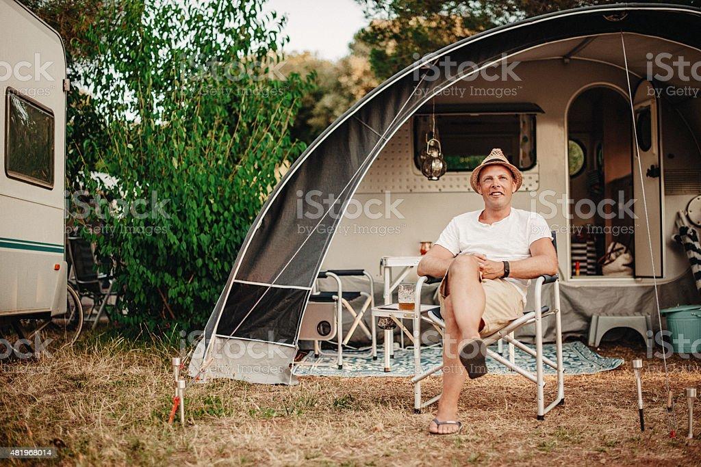 Man camping in his caravan at camping stock photo