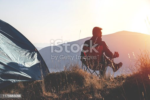 A man camping on mountains feels comfortable