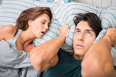 Man cannot sleep because his wife snores
