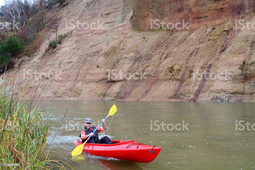 Man canoeing stock photo