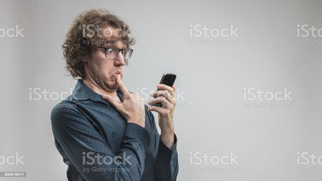 man can't use a mobile phone stock photo