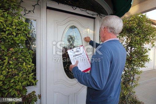 istock Man Canvassing Door to Door for the 2020 Census 1178842943