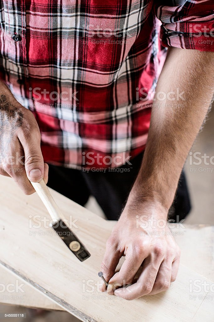 Man carpenter using hammer stock photo