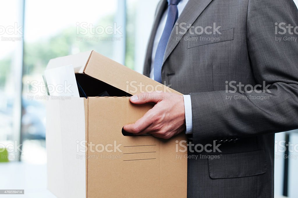 A man carrying a cardboard box stock photo