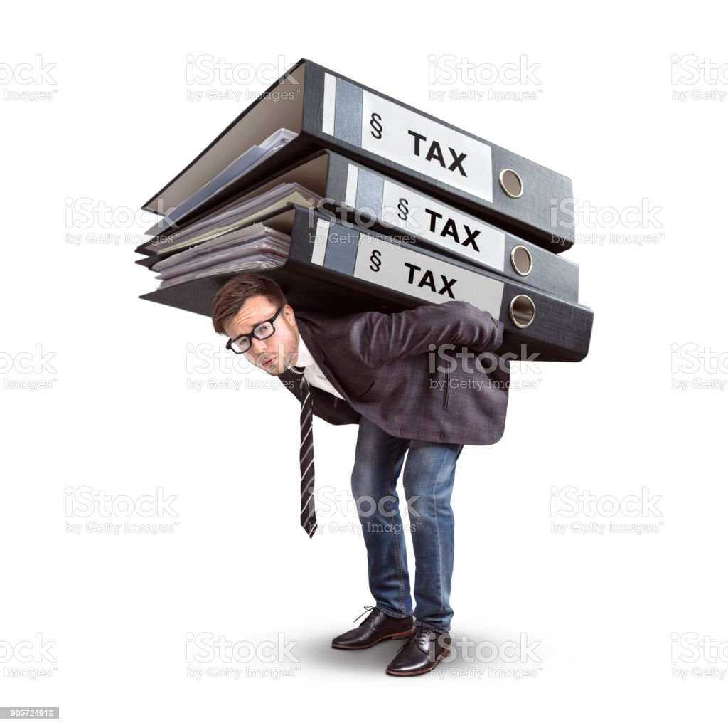 Man carrying a giant stack of tax folders - Royalty-free Accountancy Stock Photo