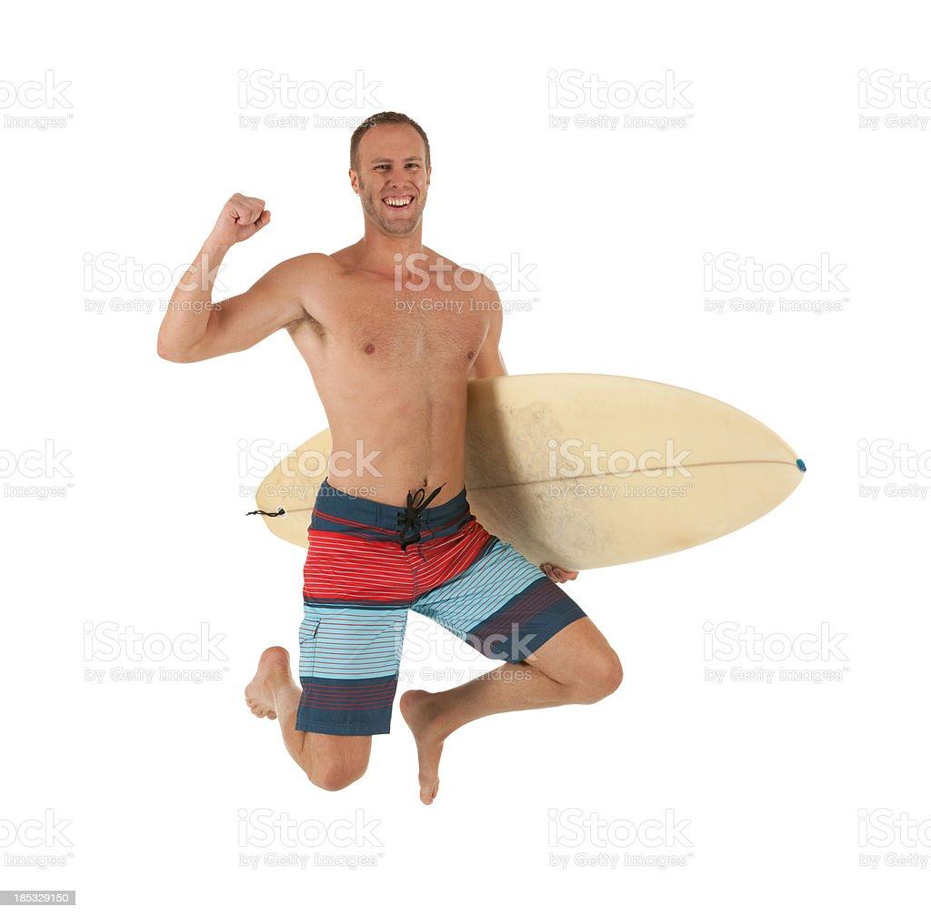 Man carrying a surfboard and smiling royalty-free stock photo