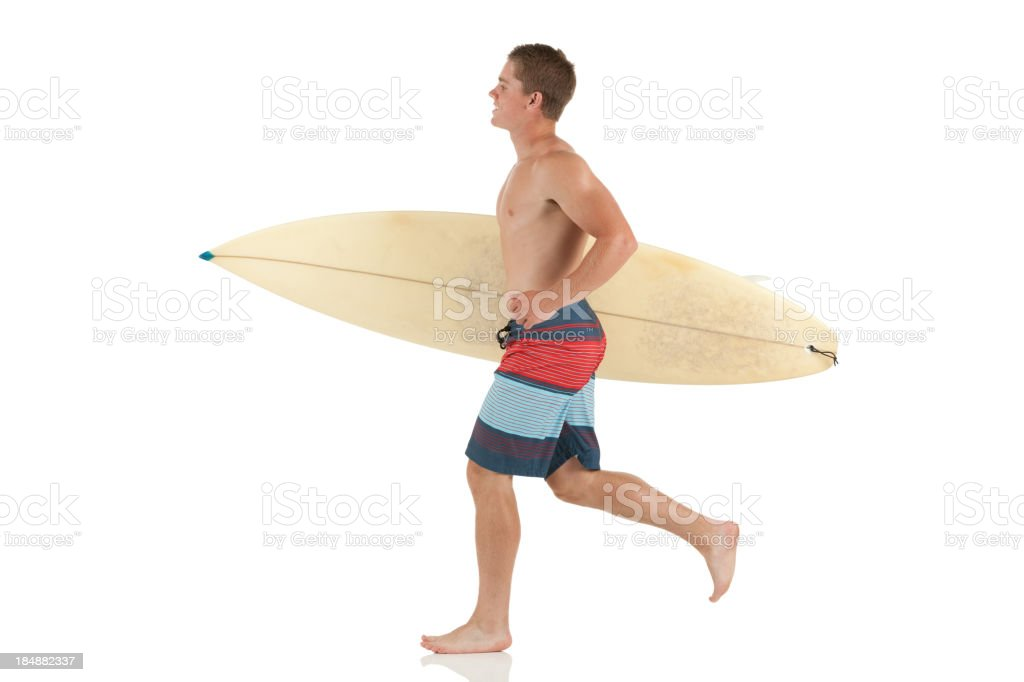 Man carrying a surfboard royalty-free stock photo