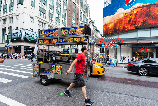 Man carrying a truck food in Manhattan, New York City, USA