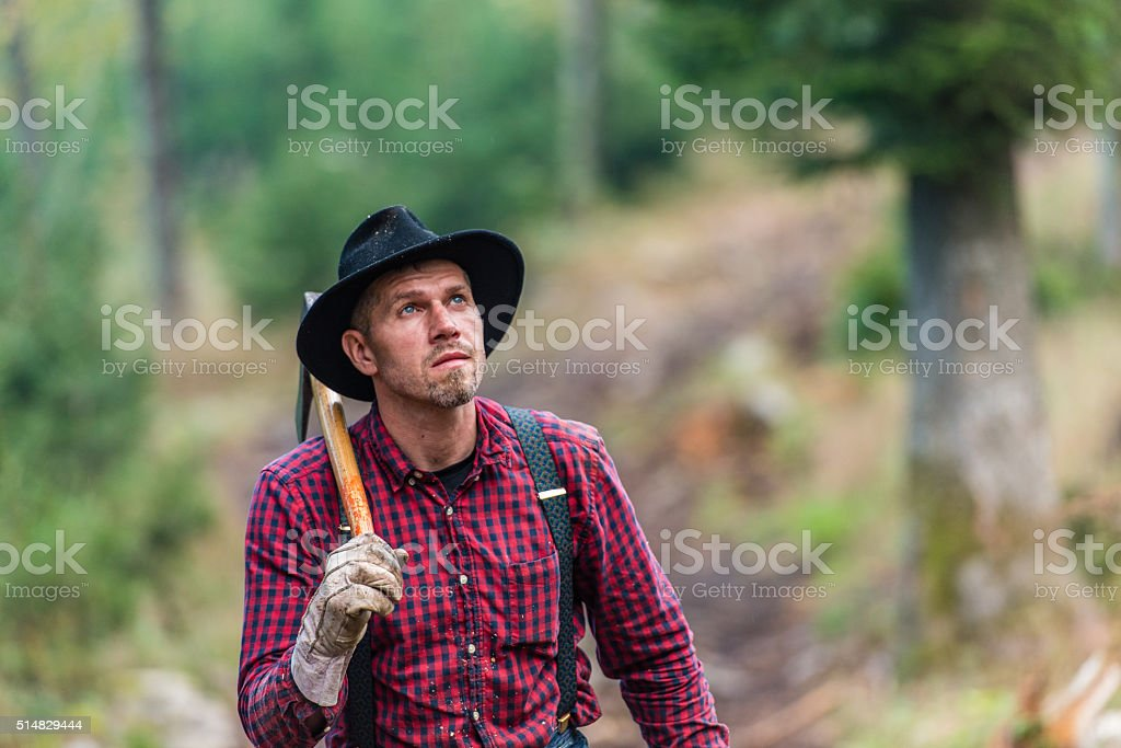 Man carrying axe stock photo