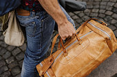 istock Man carrying bags and luggage 825478110