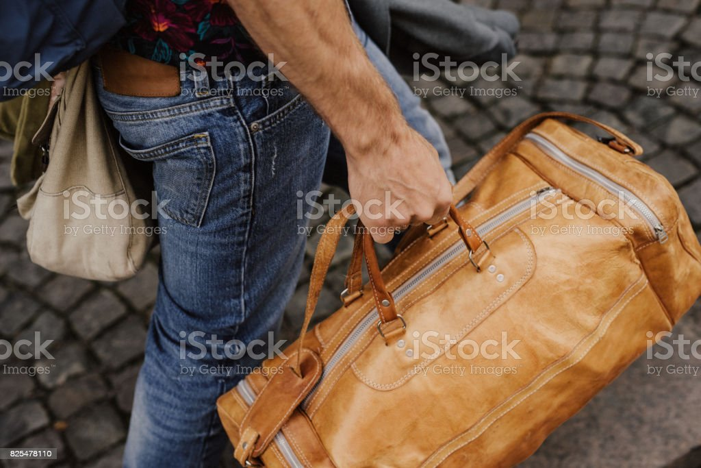 Man carrying bags and luggage stock photo