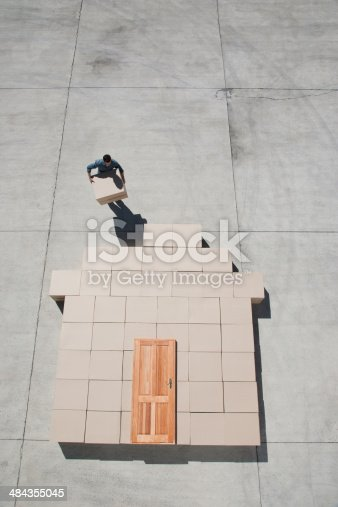 istock Man carrying boxes outdoors 484355045
