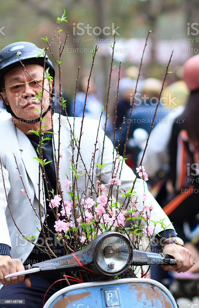 Man carrying branches in Hanoi train stock photo