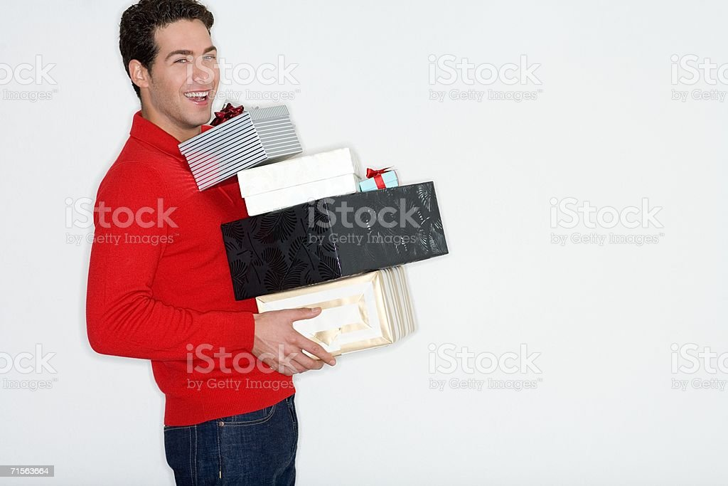 Man carrying gifts royalty-free stock photo