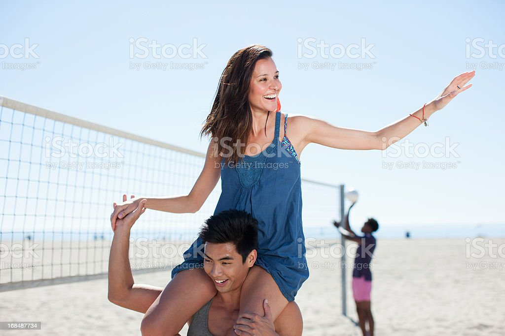 Man carrying girlfriend on shoulders royalty-free stock photo