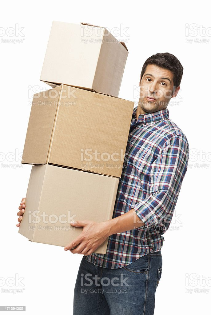 Man Carrying Heavy Stack Of Cardboard Boxes - Isolated stock photo