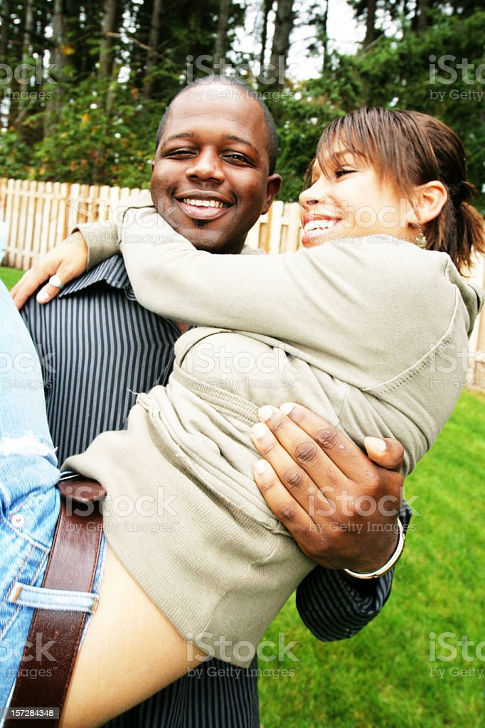 Man Carrying his Girlfriend royalty-free stock photo