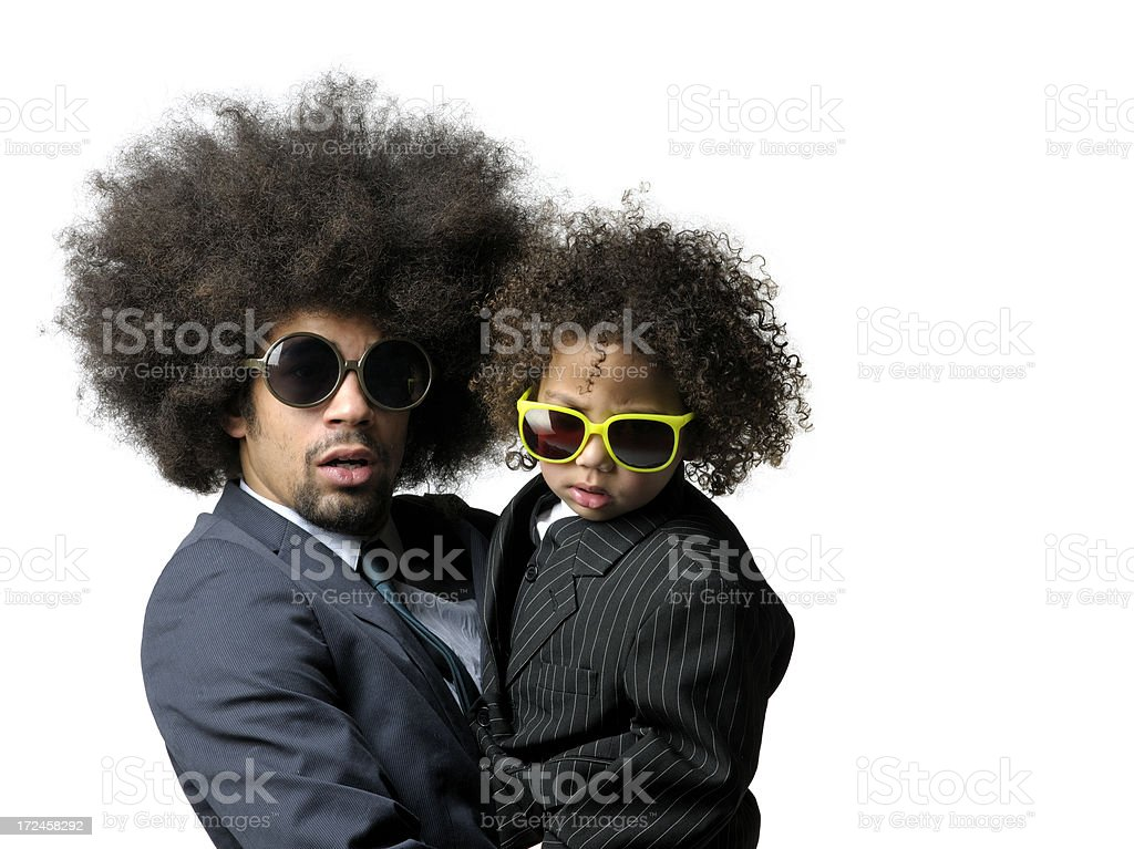 man carrying little boy with big hair and sunglasses royalty-free stock photo