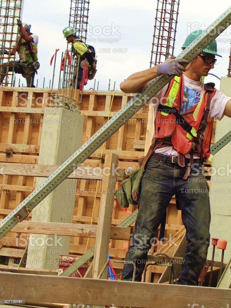 Man carrying rebar stock photo