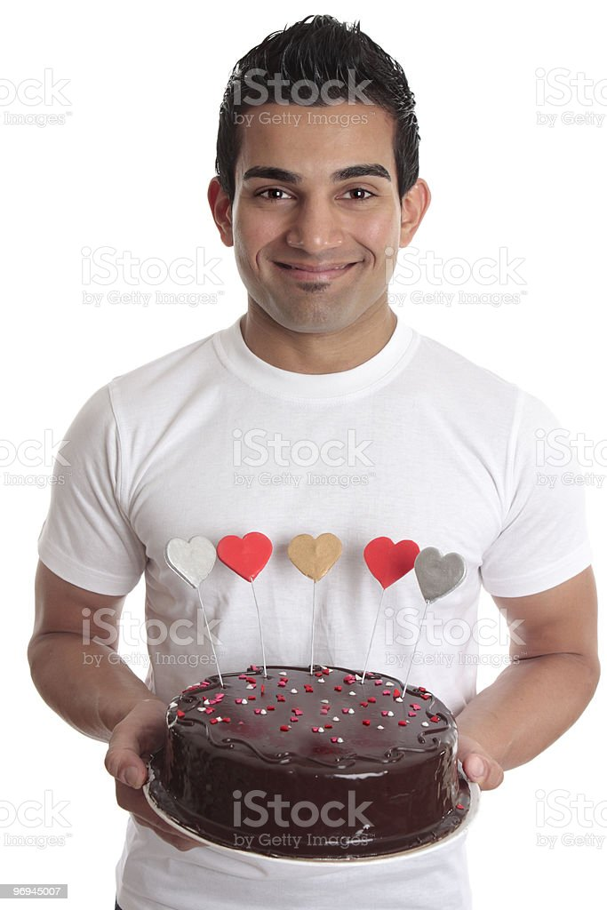 Man carrying romantic heart cake royalty-free stock photo