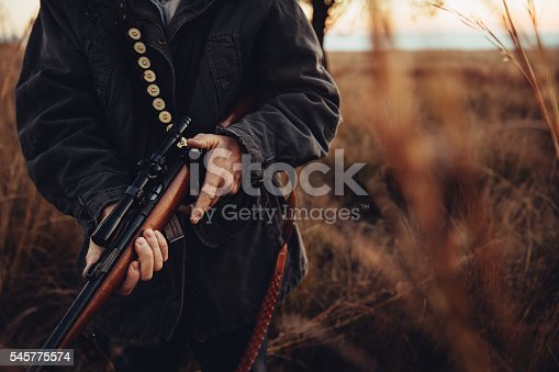 istock Man carrying sniper and cartridge in wilderness 545775574